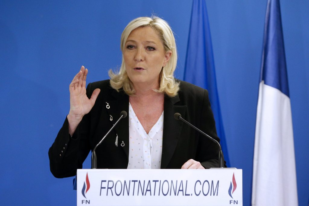epa04675084 President of the Front National (FN) Marine Le Pen delivers her speech after French media announced results following the first round of 2015 French departmental election, at the party headquarters in Nanterre, outside Paris, France, 22 March 2015. Results indicated that the far-right National Front (FN) has emerged with 24% of the vote. EPA/YOAN VALAT