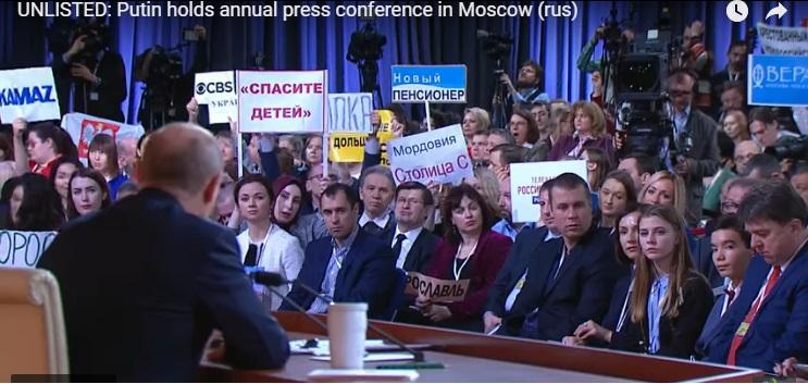 Годишната пресконференция на Путин:  3 часа и 45 минути, 1640 журналисти, плакати и виц